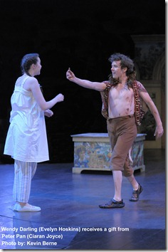 Wendy (Evelyn Hoskins) receives a gift from Peter Pan (Ciaran Joyce). Photo by Kevin Berne
