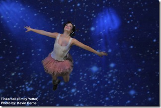 Tinkerbell (Emily Yetter) flies above the audience. Photo by Kevin Berne.